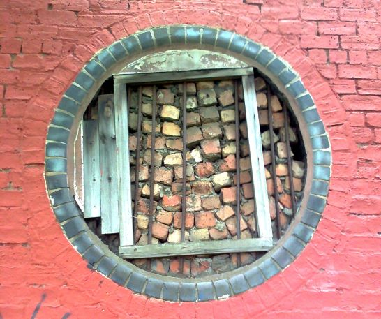 bricks in a wall, in a weird shape, like a wall within a wall